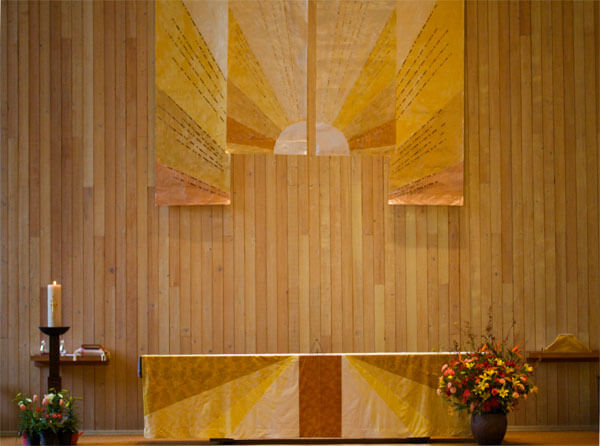 The wall hanging was made by the Ecclesiastical Arts Committee, Jennifer King sewed the altar cloth. Photo by Tom Byrd.