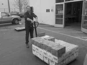 Hopelink manager with half pallet of donated food