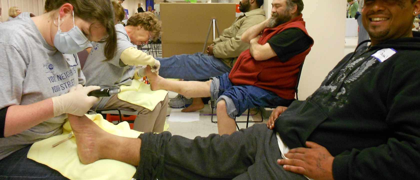 Advanced footcare while washing feet of those experiencing homelessness