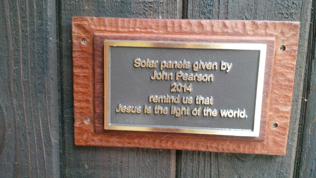 Plaque saying that the solar panels were given by John Pearson.