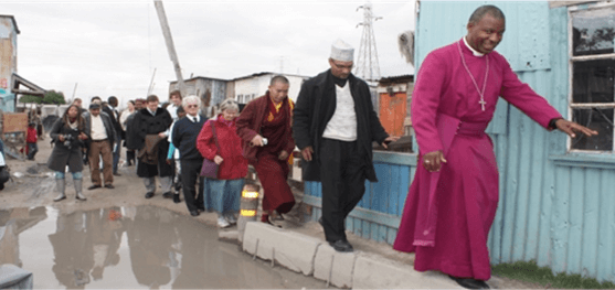"Anglican Archbishop of Cape Town Thabo Makgoba leading a ""walks of witness"" to expose these realities and to place pressure on the City government to implement real changes."