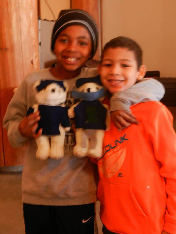 "Christmas Shopping Trip Party participants with the ""Russell Wilson"" teddy bears they made."