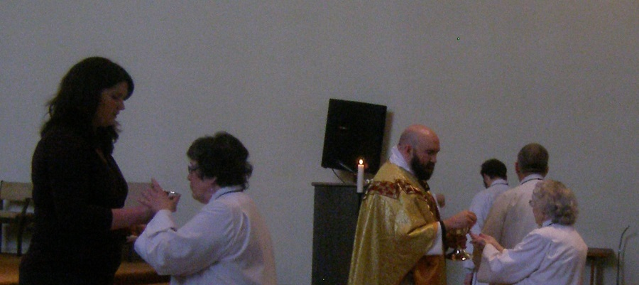 Eucharistic minister and Father Jed